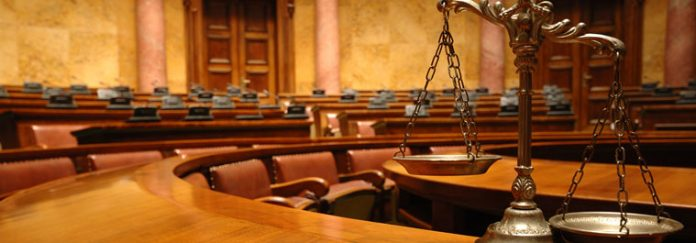 Refer the parties to arbitration in an arbitration agreement