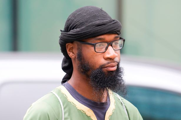 "UK: A Muslim convert said he wouldn't stand for ""any man"" before his court hearing began, but stood"